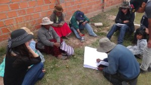 Community leaders drawing map of Piquinani